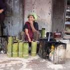 Vendeuse de laque.  Photo Marchés d'Asie